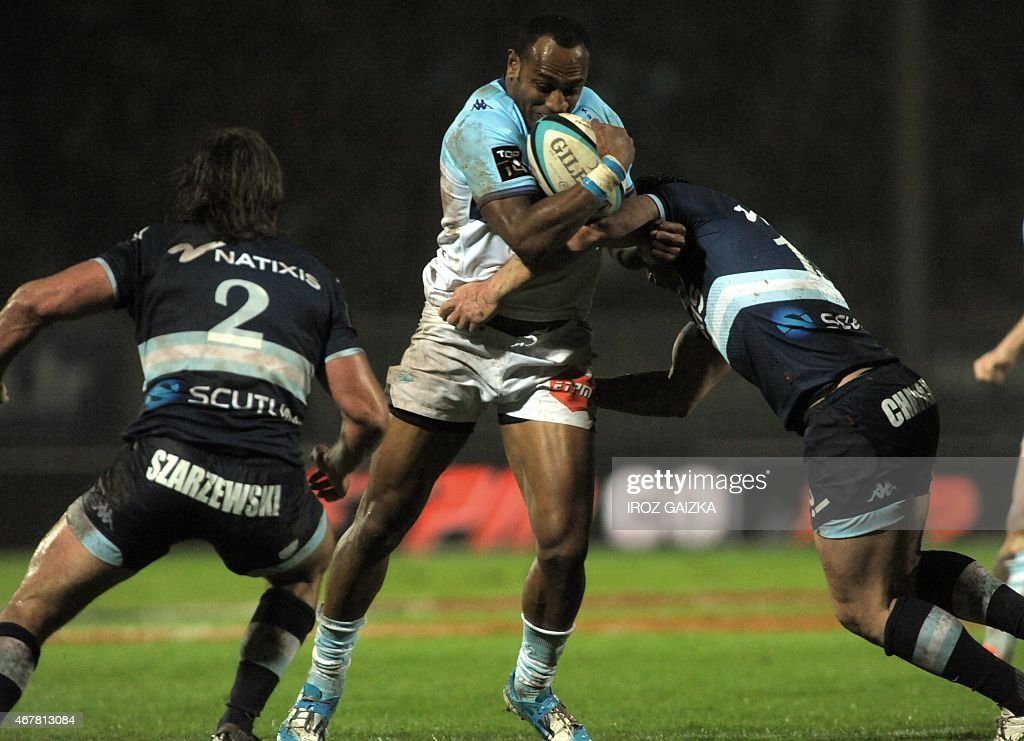 Bayonne's center Joe Rokocoko vies with Paris's french center Henry Chavancy during the Top 14 rugby union match between Bayonne and Racing Metro 92...