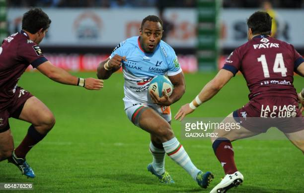 Bayonne's Fijian center Gabiriele Lovobalavu runs with the ball during the French Top 14 rugby union match Aviron Bayonnais vs UBB BordeauxBegles at...