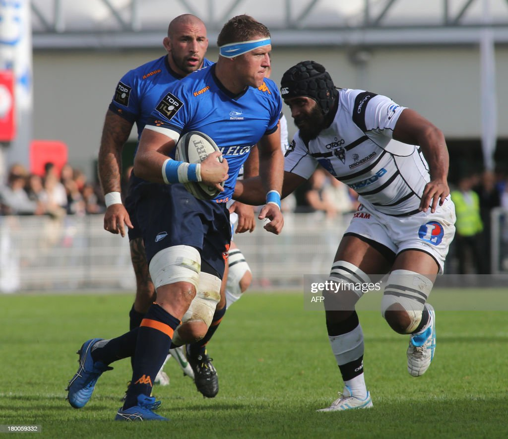 Bayonne's flanker Dewald Meyer Senekal runs with the ball during the French Top 14 rugby union match CA Brive versus Aviron bayonnais on September 8...