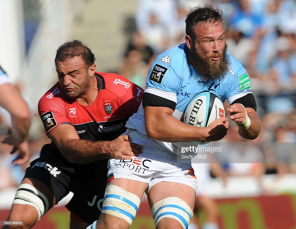 Bayonne's flanker Pieter Jan Van Lill is tackled by Toulon's georgian flanker Mamuka Gorgodze during the French Top 14 rugby union match between...