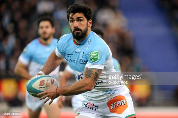 Bayonne's French center Felix Le Bourhis passes the ball during the French Top 14 rugby union match Aviron Bayonnais vs UBB BordeauxBegles at the...