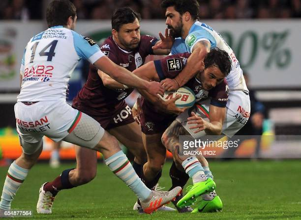Bayonne's french center Felix Le Bourhis tackles Bordeaux's fullback Nans Ducuing during the French Top 14 rugby union match Aviron Bayonnais vs UBB...