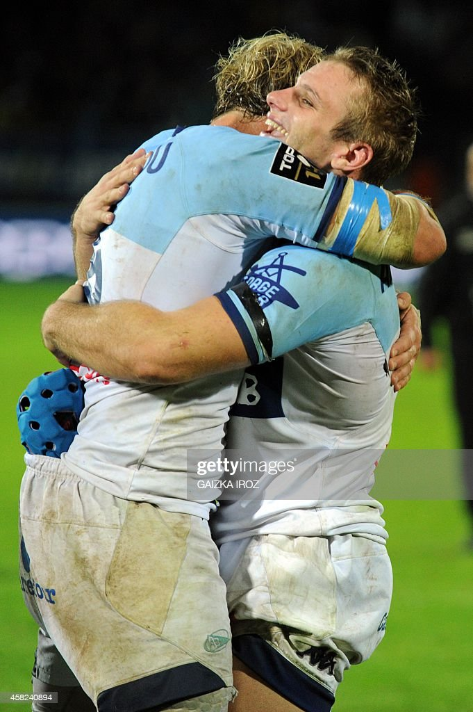 Bayonne's french flanker Jean Monribot and french winger Marvin O'Connor celebrate after winning the the French Top 14 rugby union match between...