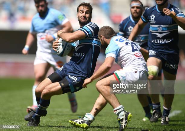 Bayonne's French scrumhalf Bastien Duhalde vies with Montpellier's French scrumhalf Benoit Paillaugue during the French Top 14 rugby union match...
