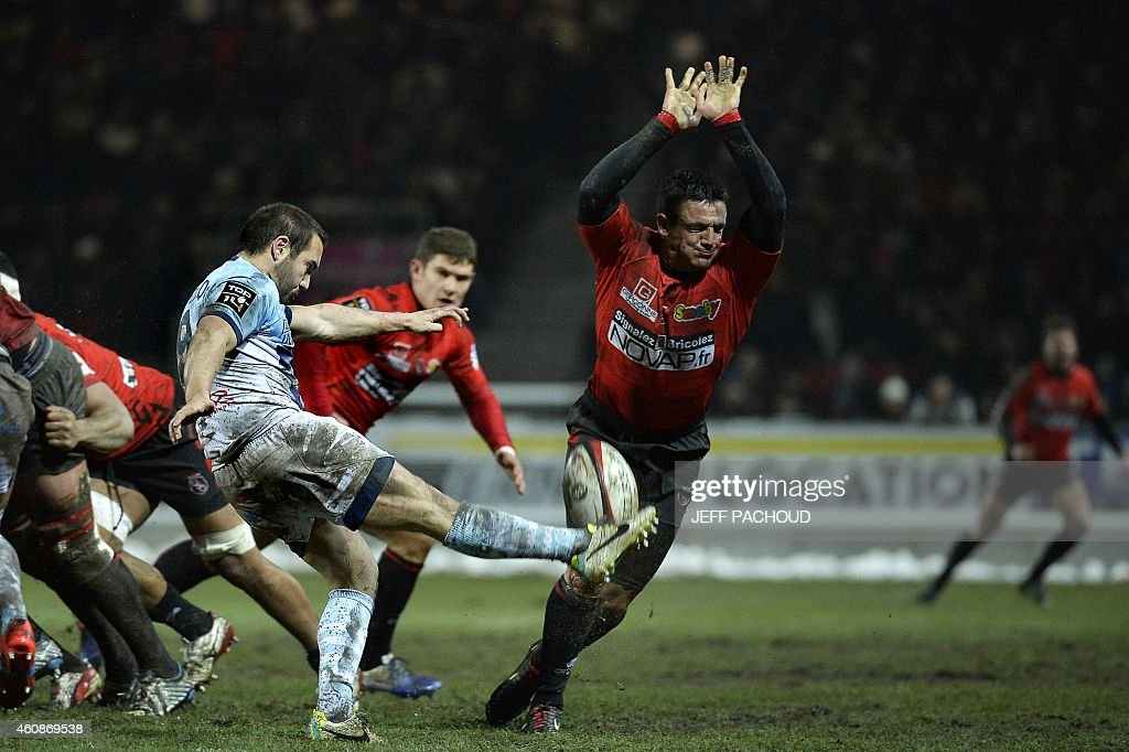 Bayonne's French scrumhalf Christophe Loustalot is countered by Oyonnax's South African flyhalf Conrad Barnard during the French Top 14 rugby union...