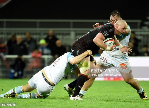 Bayonne's French wing Romain Martial tackles Lyon's English flanker Carl Fearns during the French Top 14 rugby union match Lyon vs Bayonne on March...