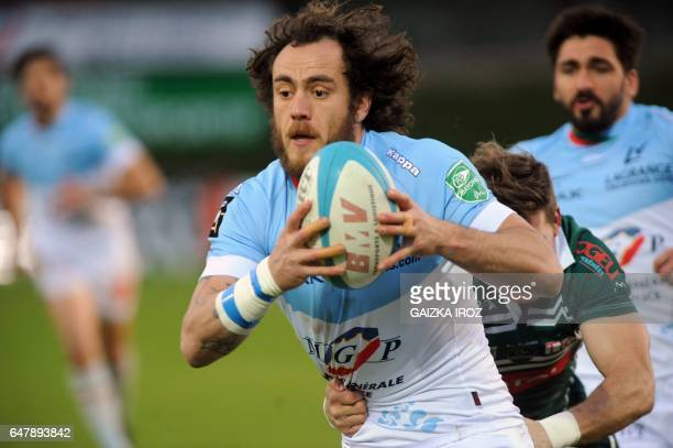 Bayonne's French winger Julien Jane runs with the ball during the French Top 14 rugby union match between Bayonne's Aviron Bayonnais and Pau's...