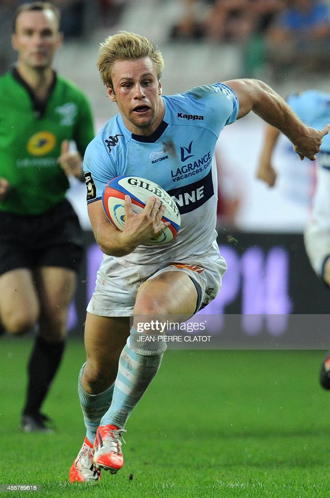 Bayonne's French winger Marvin O'Connor runs with the ball during the French Top 14 rugby union match Grenoble vs Bayonne on september 20 2014 at the...