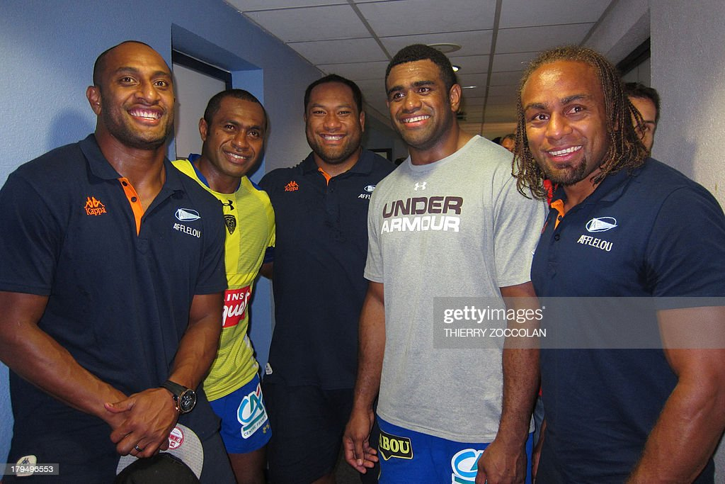 Bayonne's New Zealand winger Joe Rokocoko, Clermont's Fidji winger Sitiveni Sivivatu, Bayonne's New Zealand prop Neemia Tialata, Clermont's Fidji winger Napolioni Nalaga and Bayonne's Fidjian center Gabriele Lovobalavu pose after the French Top 14 rugby union match ASM Clermont Auvergne vs Aviron Bayonnais Rugby on September 4, 2013 at the stadium Marcel Michelin in Clermont-Ferrand, central France.