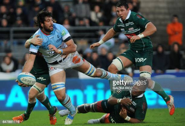 Bayonne's second row Pablo Huete passes the ball during the French Top 14 rugby union match between Bayonne's Aviron Bayonnais and Pau's Section...