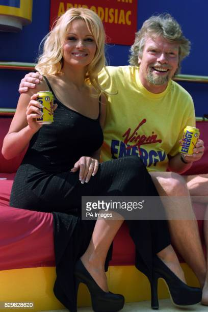 LONDON 220595 Baywatch star Pamela Anderson and Virgin chief Richard Branson pose on a huge bed in a 'live poster site' in London today to launch a...