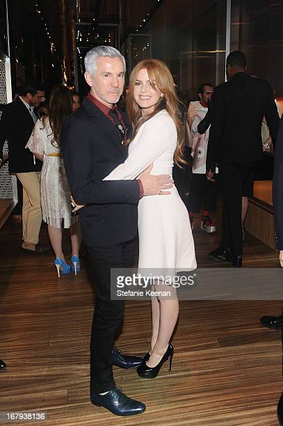 Baz Luhrmann director/producer/cowriter of 'The Great Gatsby' and actress Isla Fisher both wearing Prada attend Catherine Martin And Miuccia Prada...