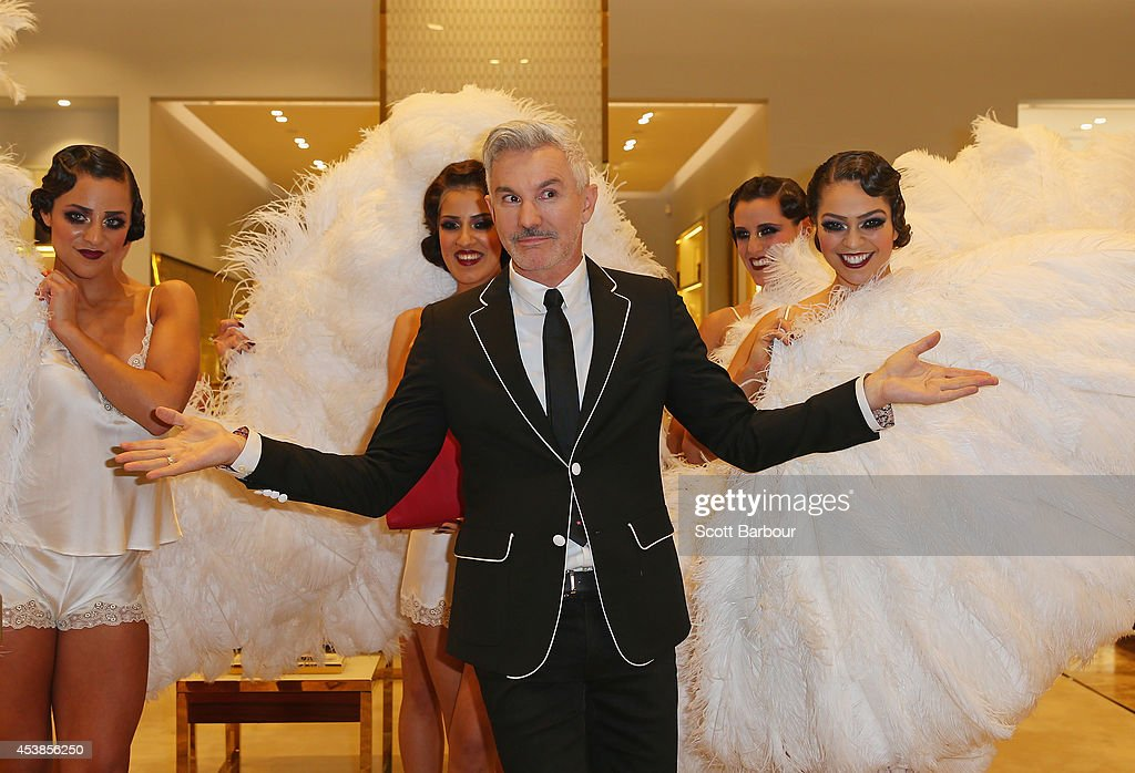 <a gi-track='captionPersonalityLinkClicked' href=/galleries/search?phrase=Baz+Luhrmann&family=editorial&specificpeople=209230 ng-click='$event.stopPropagation()'>Baz Luhrmann</a> poses with models inside of a store as he attends the launch of Emporium Melbourne on August 20, 2014 in Melbourne, Australia.