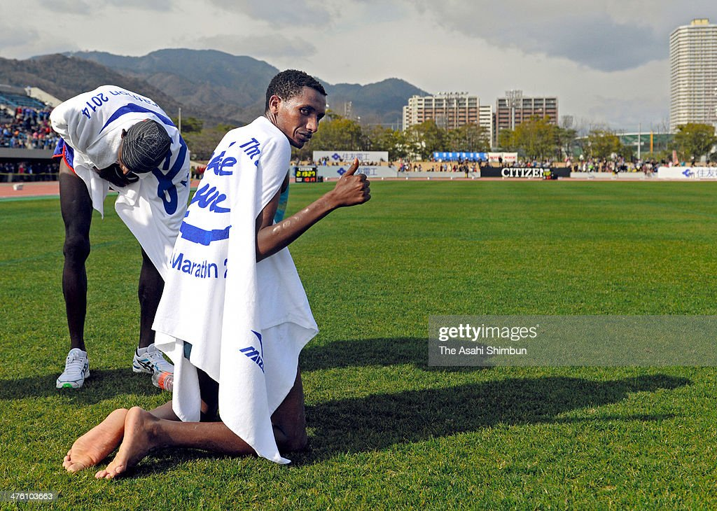 Bazu Worku of Ethiopia celebrates winning the 69th Lake Biwa Mainichi Maration at Ojiyama Stadium on March 2, 2014 in Otsu, Shiga, Japan.