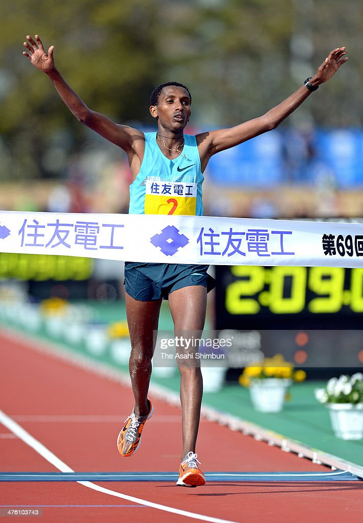 Bazu Worku of Ethiopia crosses the finishing tape to win the 69th Lake Biwa Mainichi Maration at Ojiyama Stadium on March 2, 2014 in Otsu, Shiga, Japan.