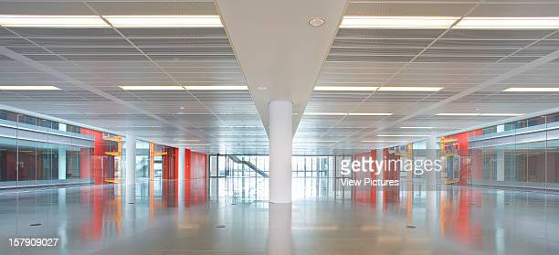Sr/Sheppard Robson London Large Colourful Interior Space With Central PillarOffice Architect