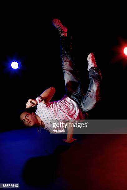A B-boy doing a Pike Freeze breakdance move
