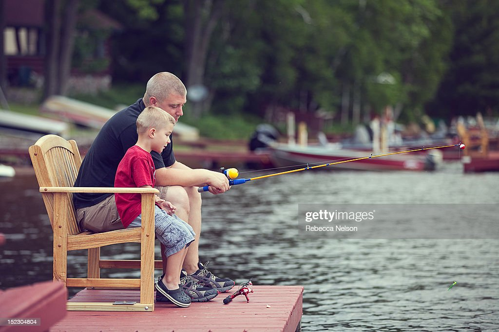 Bboy fishing with his father : Stock Photo