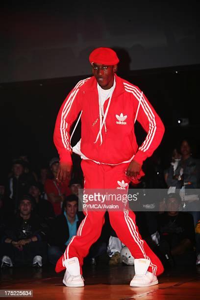 BBoy in red tracksuit dancing at UK BBoy Championships 2005