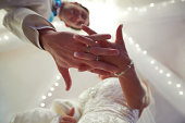Bbride and groom holding hands