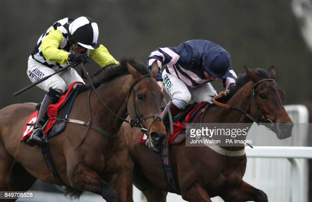 Be All Man ridden by Jamie Moore on the way to winning The David Lindon Co handicap hurdle race from second placed Leader of the Gang ridden by Tony...