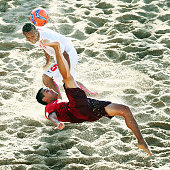 Be of Portugal does a scissor kick next to Raimoana Bennett of Tahiti during the FIFA Beach Soccer World Cup Portugal 2015 Final between Tahiti and...