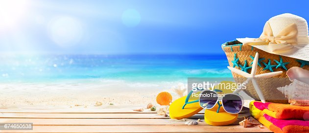 Beach Accessories On Table On Beach - Summer Holidays : Stock Photo