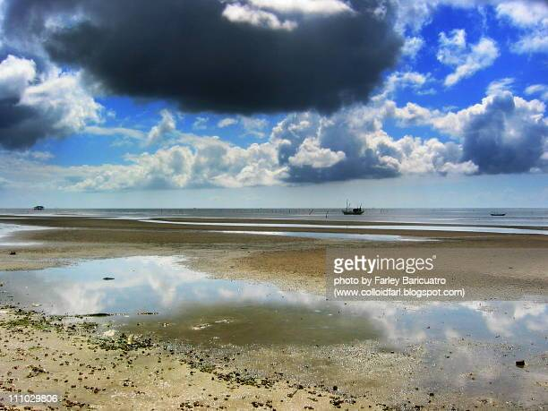 Beach and boats with cloud sky