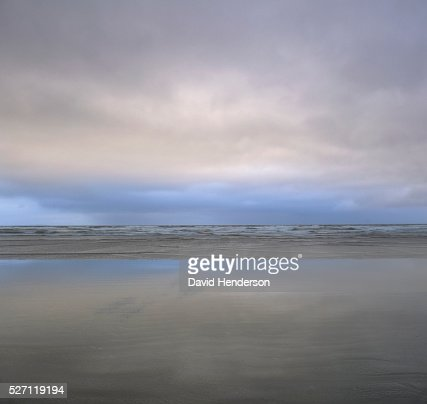 Beach and clouds : Stock Photo