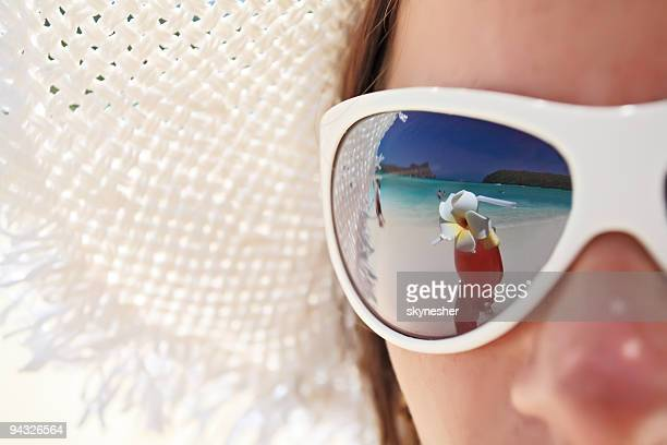 Beach and cocktail in girl's sunglass.