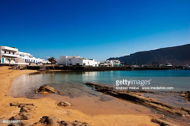 Beach and harbour in Caleta del Sebo, La Graciosa