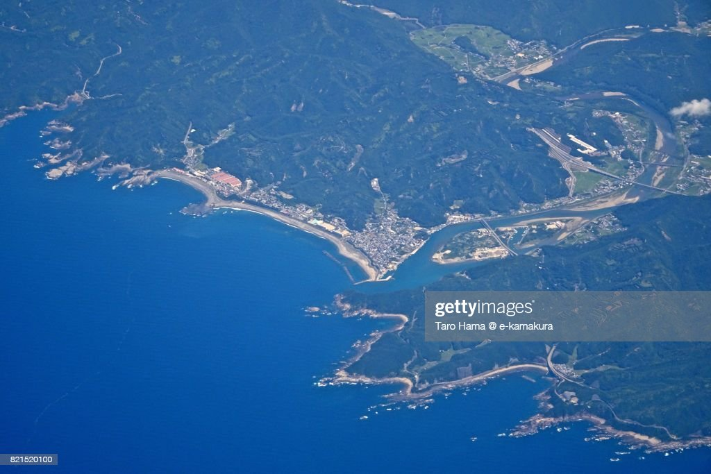 Beach and seaside line in Shirahama town in Wakayama Prefecture daytime aerial view from airplane : ストックフォト