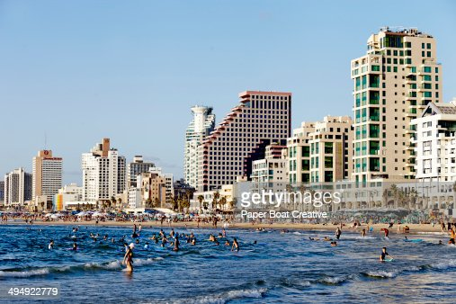 Beach and skyscrapers in the back, at Tel Aviv