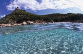 Beach and tower in the background Cala Giunco Villasimius Sardinia Italy