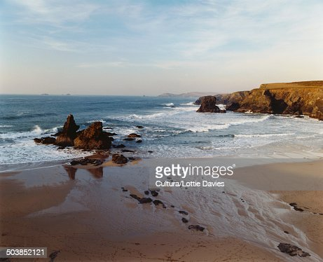 Beach at sunset, sea, surf and rocks