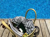 Beach bag by swimming pool