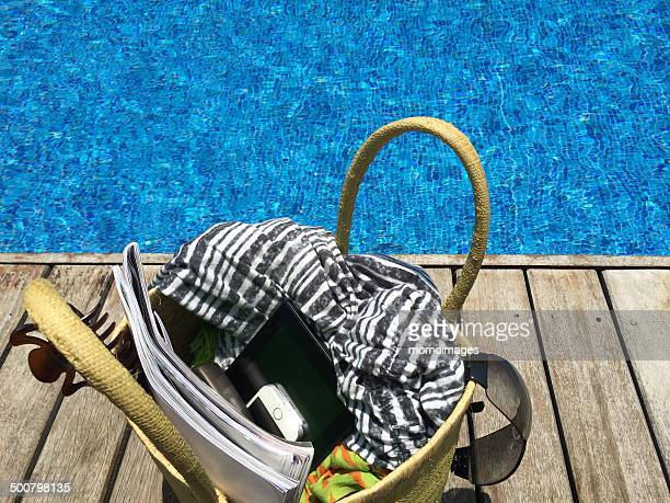 Beach bag by swimming pool