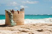 Beach bag on sandy beach, Mustique, Grenadine Islands