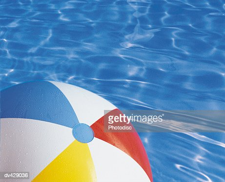 Pool Water With Beach Ball beach ball in water stock photo | getty images