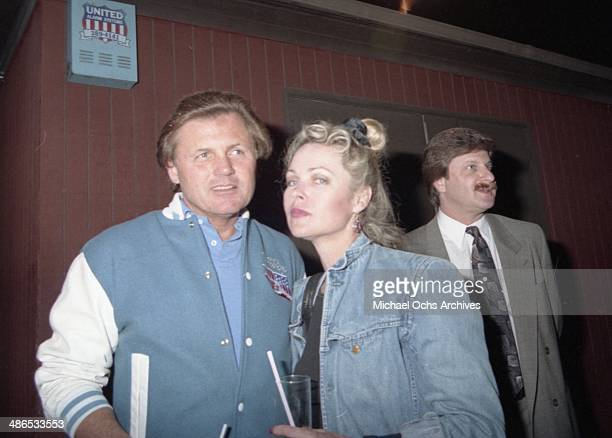 Beach Boy Bruce Johnston and Mamas and The Papas member Michelle Phillips outside of The Baked Potato on April 19 1990 in Los Angeles California