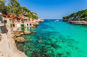 Summer holiday at the beach of Cala Llombards on Mallorca, Balearic islands.