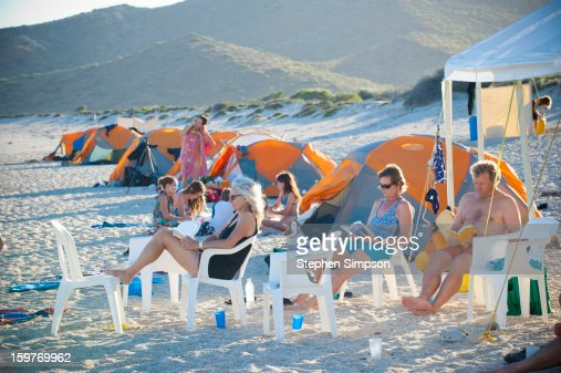 beach camping tableau with three book readers : Stock Photo
