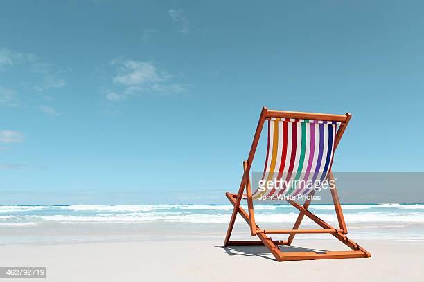 Beach chair with rainbow stripes. Australia