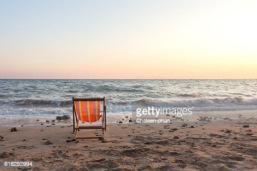 Beach chair with sunset : Stock Photo