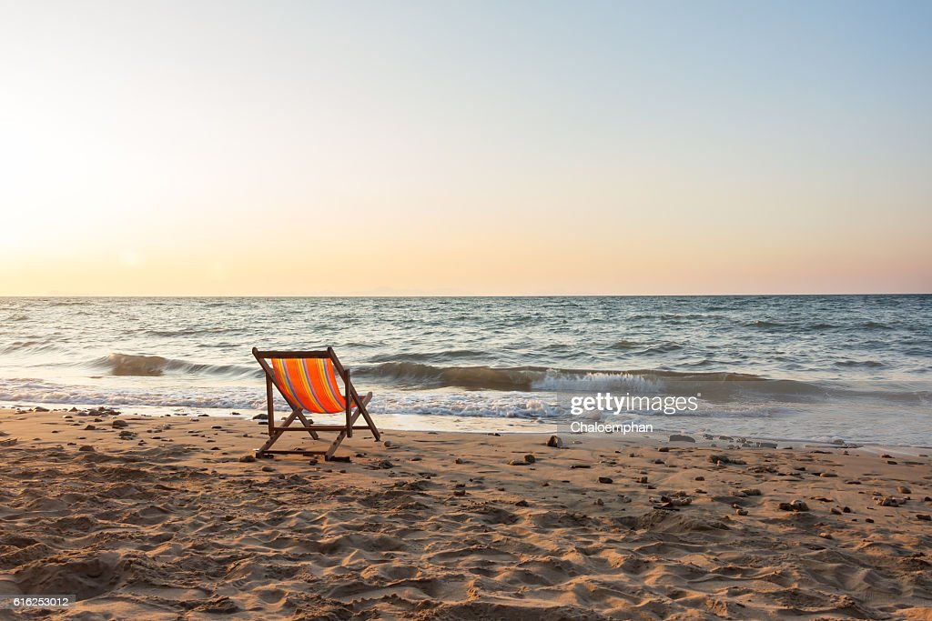 Beach chair with sunset : Foto de stock