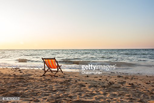 Beach chair with sunset : Foto de stock