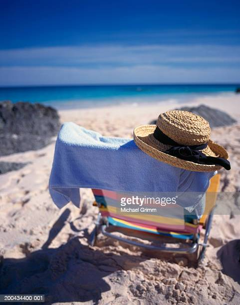 Beach chair with towel and hat