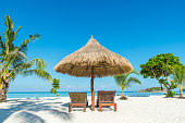 Summer, Travel, Vacation and Holiday concept - Beach Chairs and Umbrella on island in Phuket, Thailand