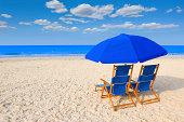 Beach chairs and umbrella