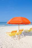 Beach chairs and umrella